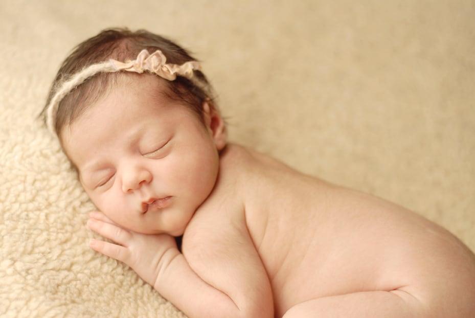 newborn baby girl posed