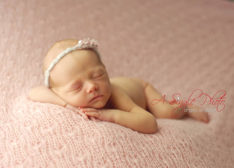 baby girl posed newborn